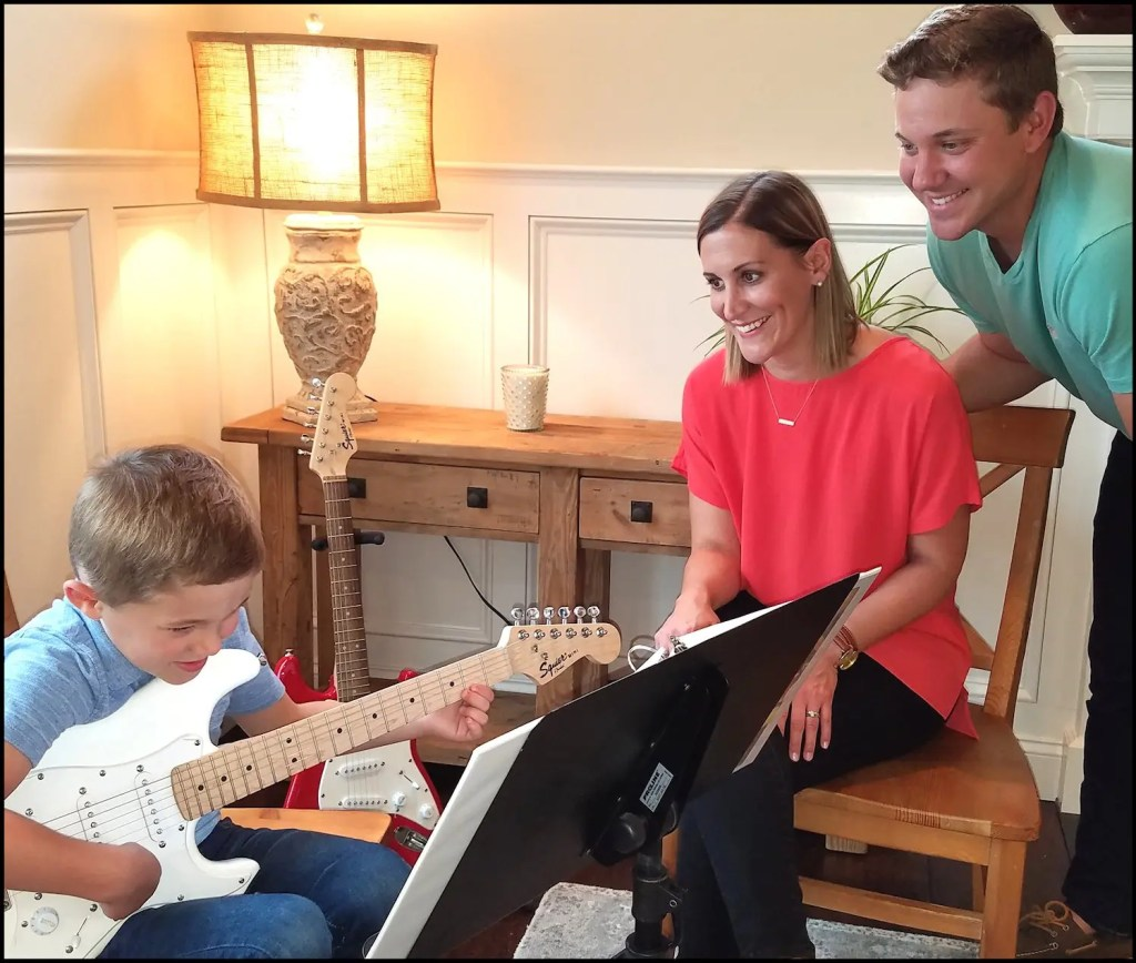 Families enjoy playing and singing together.