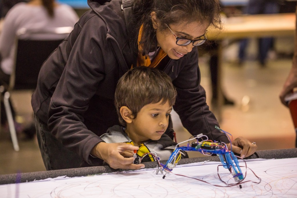 Kids and parents learn together at Maker Faire.