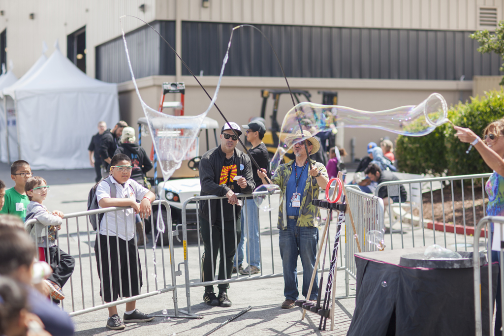 SAN MATEO, CA May 20 2016 - Bubble wrangler Brian Lawrence demonstrating for a gathering of young schoolchildren during the 11th Annual Maker Faire Bay Area at the San Mateo County Event Center.