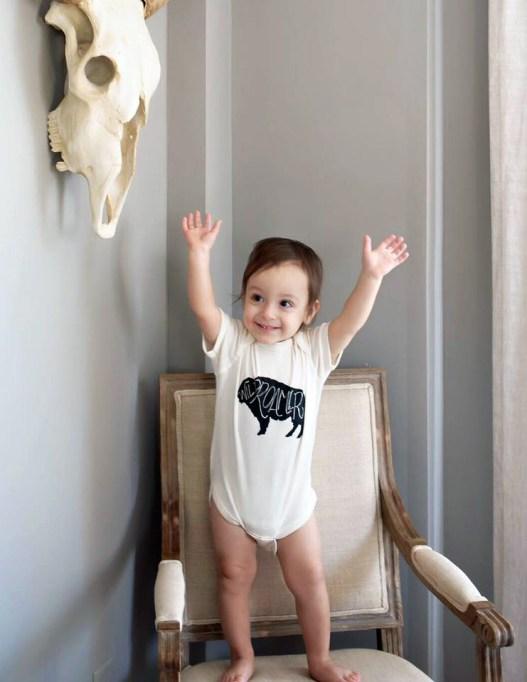 rusterior-wild-roamer-kid-wearing-shirt-arms-up
