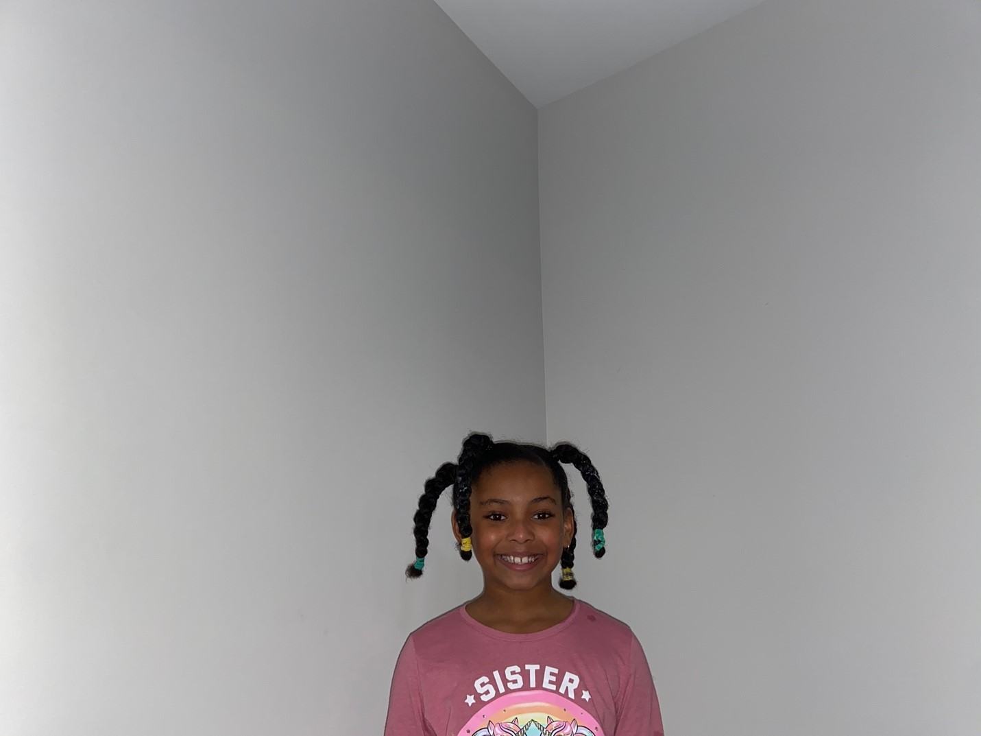 "10: Isabella smiling with her freshly braided hair after enduring ""wash day"". Two-Point Perspective (Block, 18-21)"