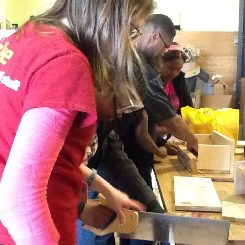 Mentors and Club Makers work on sawing and assembling boxes.