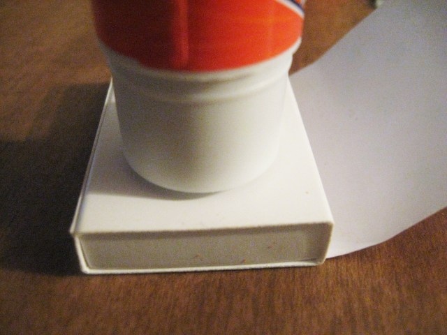 gluing paper to matchbox