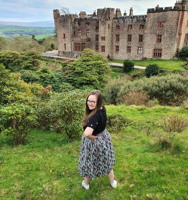 Kym with castle cat skirt over shoulder view