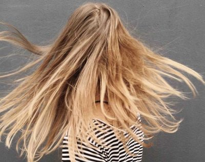 Blonde hair blowing in the wind
