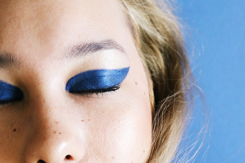 photo of woman closing her eyes   graphic eyeliner tutorial