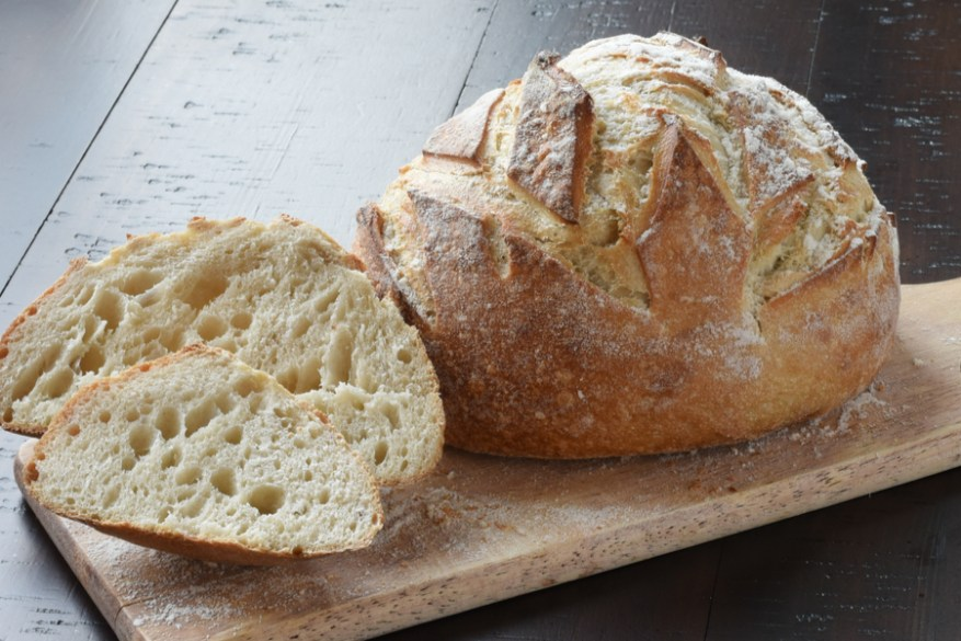 Even if you've never made homemade bread or worked with yeast before, this homemade crusty artisan bread is for you. It's the perfect beginner recipe because it only requires a few ingredients that everyone has at home.