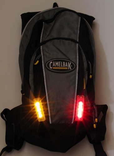 Integrated backpack bike flashers