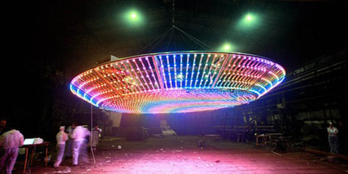 Illuminated UFO lights up the skyline