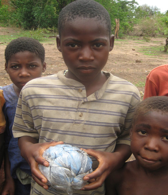 Kids in Malawi make toys from junk