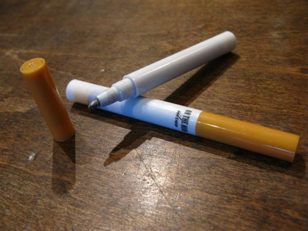 Graffiti marker disguised as cigarette
