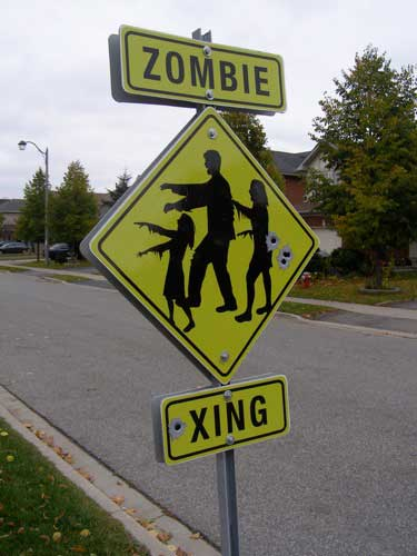 Zombie crossing road sign