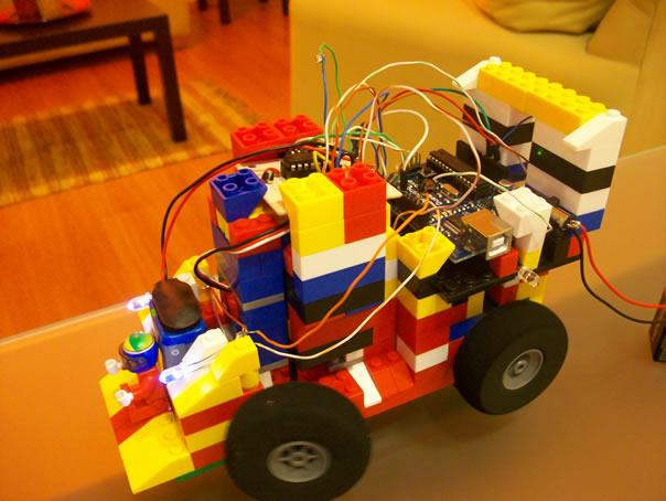 Robot body by Lego, brains by Arduino