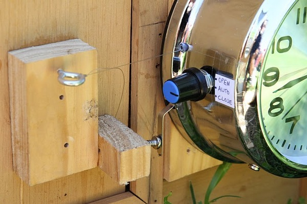 Automatic chicken coop door opener