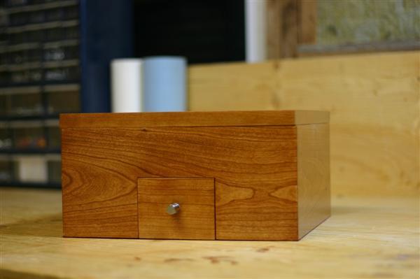 The Frustromantic Box: A reverse geocache puzzle