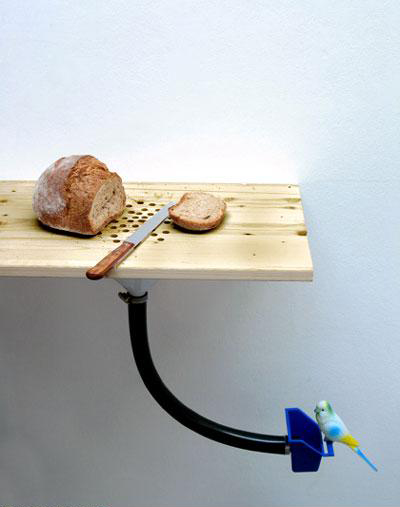 Crumb-disposing cutting board