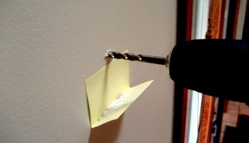 Use a post-it to catch drill dust