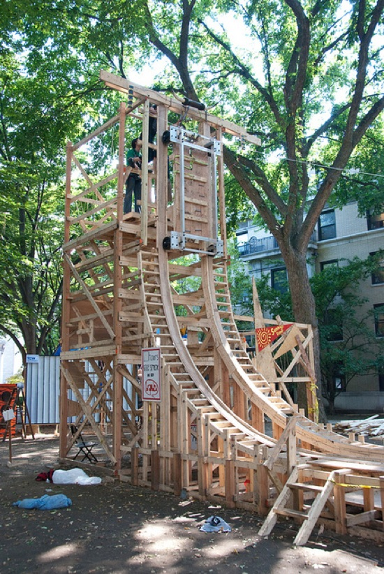 Students make vertical wooden roller coaster track