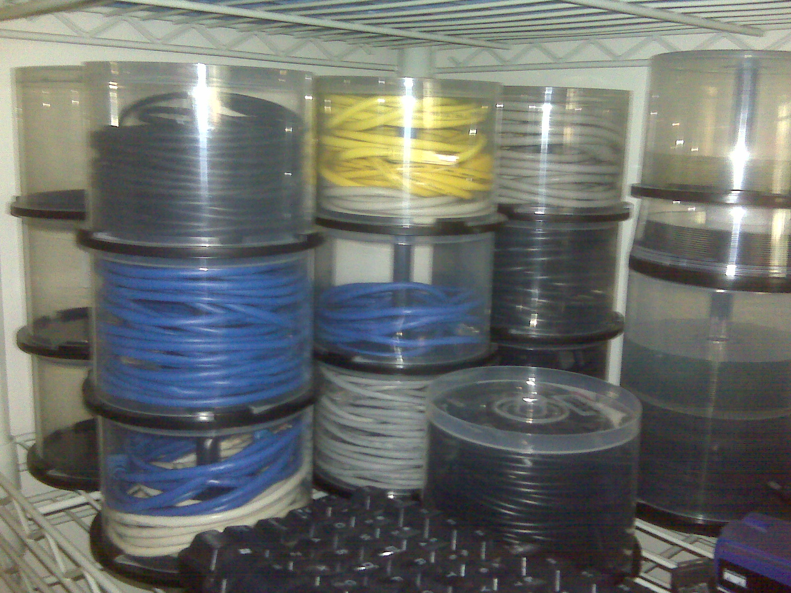 Reusing old optical disc spindles for cable storage