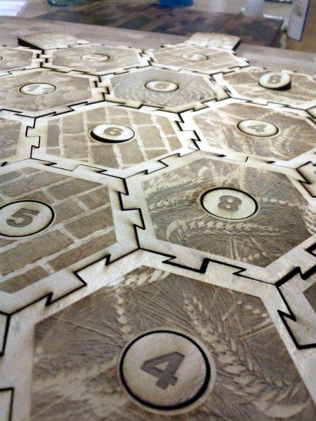 Laser-cut interlocking Settlers of Catan tiles