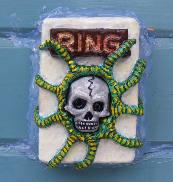 Cast-plastic doorbell cover