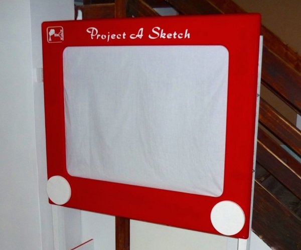 Giant etch-a-sketch built using projector