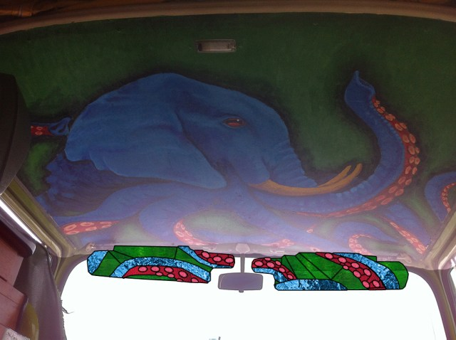 VW Bus Customized with a Mural and Stained Glass