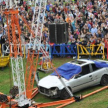 """The culmination of the Life Size Mousetrap's immense Rube Goldberg machine: a safe plunges from 600 feet (""""mouse feet"""") onto the windshield of a hapless car, to the delight of crowds. (Gregory Hayes / MAKE)"""