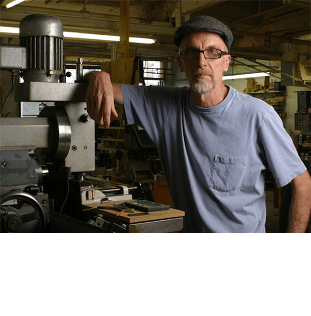 """""""I stand here next to the Aciera F3 - a wonder of Swiss engineering designed with a small working envelope ideal for the typical range of work I do. It has a different operator layout from the typical Bridgeport style milling machines."""""""