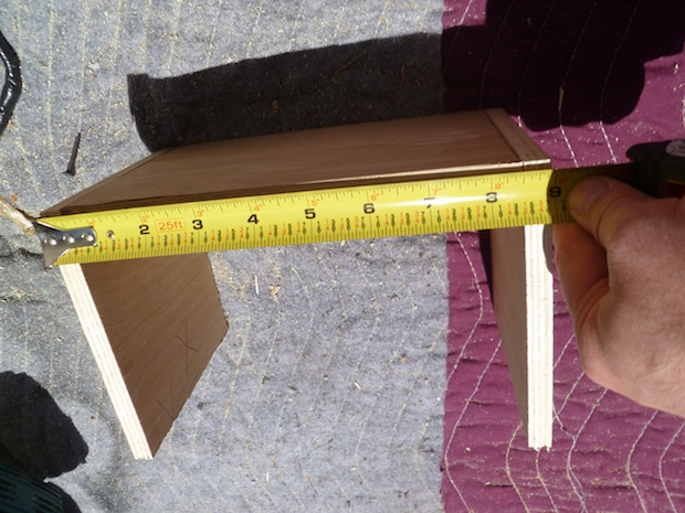 Use a tape measure to find the entire length of the box. This includes the base and the sides. This one is 8 and 15/16""