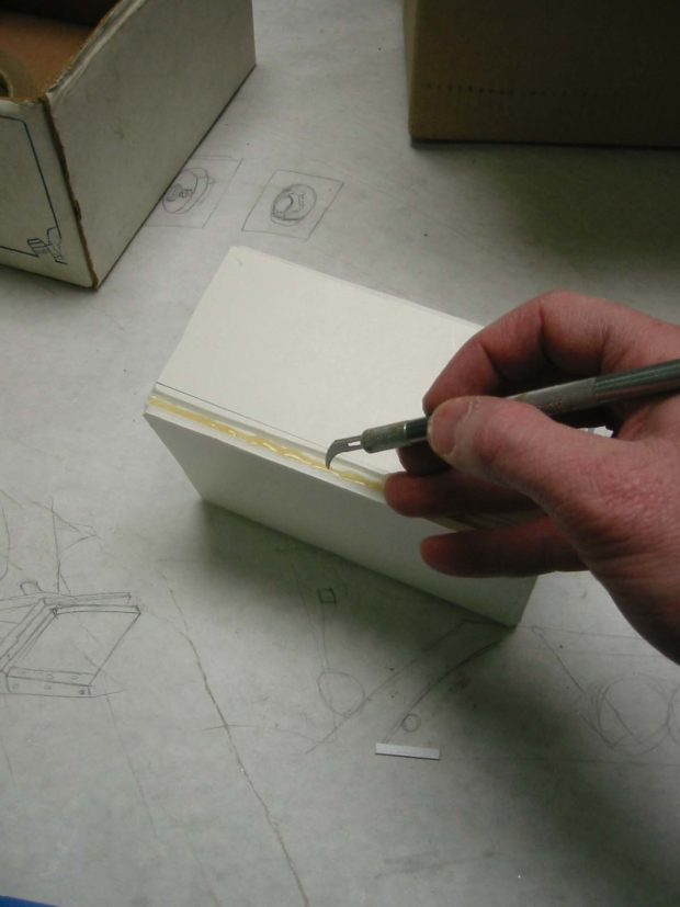 Fig. K: Cutting the box seam.