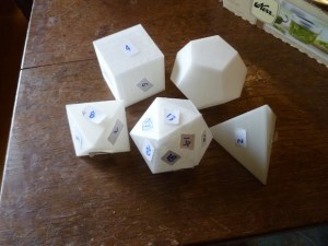 No, he doesn't play D&D, he's just into platonic solids. He made these with his MakerBot.