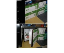Hide your mini fridge by cutting out a side of a cardboard box (the size will vary depending on the size of your fridge) and glue or tape the cardboard to the front. Now, what was once your fridge just looks like a storage box.