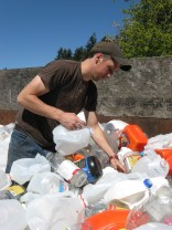 Team member Brandon Bowman collecting milk cartons for printing.