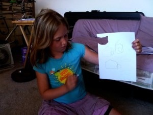 Eva took pencil to paper to come up with ideas for our cat house.