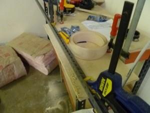 Gluing veneer in the workshop.