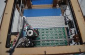 This what everyone was looking at in the image before; the top of the image is a line of resistors that are ready to be pick-and-placed. If you look closely you can see a few lines of resistors have already been applied to the PCB.