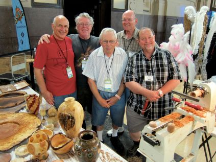 The KC Woodturners and the KC Woodworkers Guild are both 20+ years old and share a warehouse full of tools (KC Woodturners alone have 12 lathes) and run open houses, workshops and social events. http://www.kcwoodturners.org