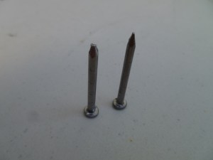 Set that nail on its head and bang it a few times to blunt it. This makes the nail push through rather than split the grain apart.