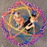 """My kids love the extra-large Hoberman Sphere we have. They usually use it to make an instant pop-up near-sphere playhouse, draping large large fabric pieces over it and adding it to a network of tunnels and boxes in the living room. Closed, it's about 18""""/half a meter across. When expanded, it's about 6 feet/2 meters in diameter. We just can't get enough of Hoberman's transformations, such an elegant choreography of joints and geometries--they are like magic."""
