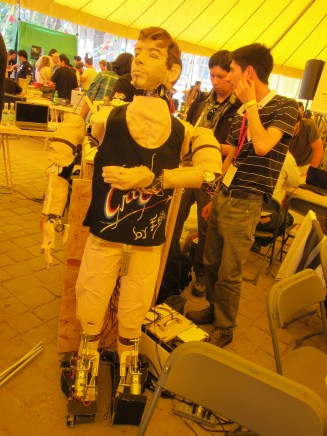 Eric's interest is in human behavior; the robot has voice recognition and runs through a series of familiar human gestures