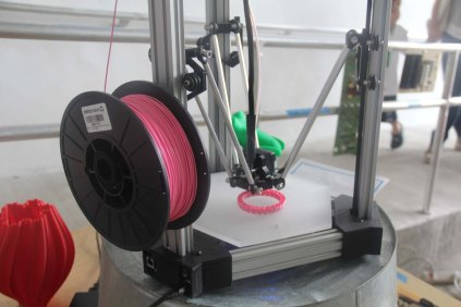 This DeltaMaker 3D printer was at the entrance so that attendees in line could learn about 3D printing.