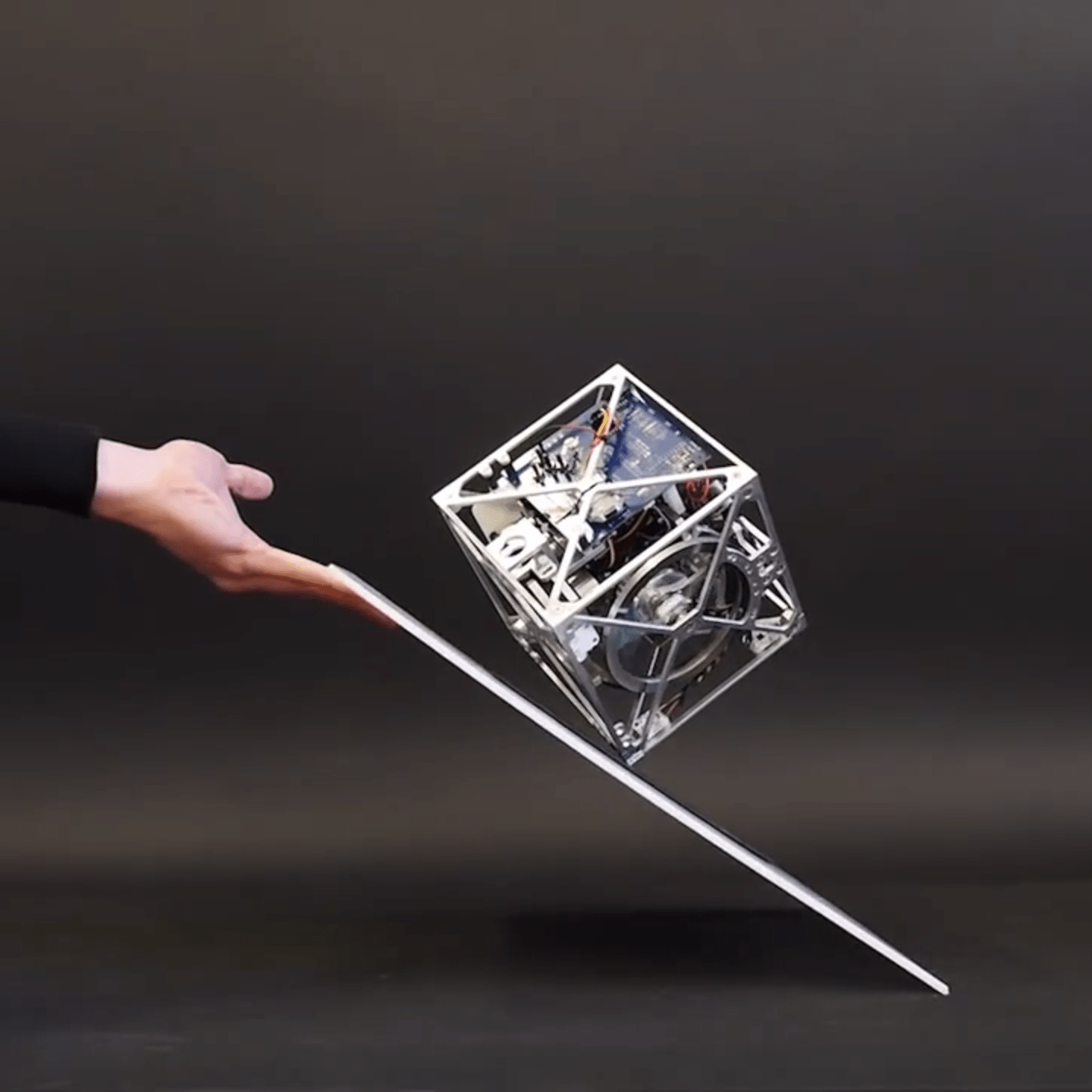 Cubli: The Cube That Can Walk and Jump