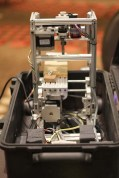 Elijah Insua built a CNC mill that folds out of a pelican case. He packed the bits, but took the CNC on the airplane!