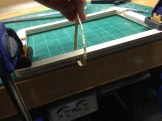 Smoothing out the SD slot with a strip of sand paper.