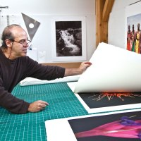 Jon Cone flips through his large scale prints.