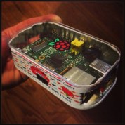 My Raspberry Pi is packed like sardines…literally! I cut open a sardine can from the bottom (leaving the peel-away tab on the top intact) & crammed my Raspberry Pi in. There is absolutely NO wiggle room! It works brilliantly too! I cut holes in the sides to accommodate the exposed ports & covered the top with a hand-cut/hand-sanded acrylic lid complete with hand-painted Raspberry Pi logo! It's the first of it's kind I've seen anywhere. Now, if only I could get rid of that sardine smell…