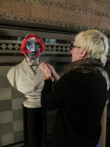 Manchester Town Hall Yarn Bombed With Crocheted Masks