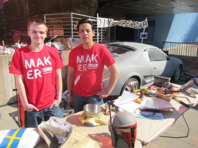 """Koji Allen (right) and intern showed and worked on his DIY SuperCar. Watch for Koji's forthcoming book, """"The Working Man's Guide to Auto Design."""" http://on.fb.me/Q9lZnV"""