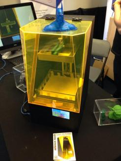 Las Vegas Mini Maker Faire sponsor FSL3D had an early model of their upcoming Pegasus Touch resin 3D printer at their booth, along with quite a few printed objects.